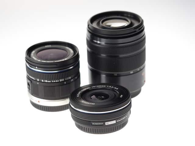 Three DSLR camera lenses