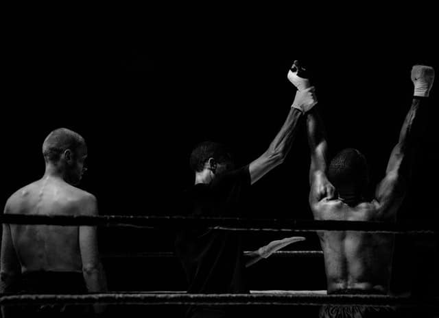Black and white image of winning boxer