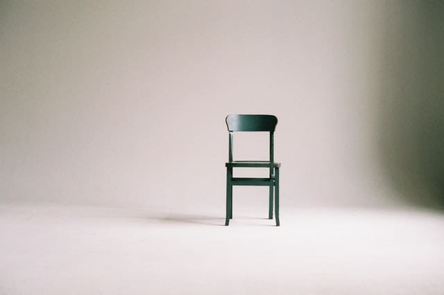 green-wooden-chair-in-white-seamless-cove