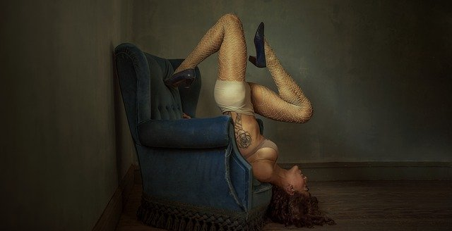 woman upside down in chair