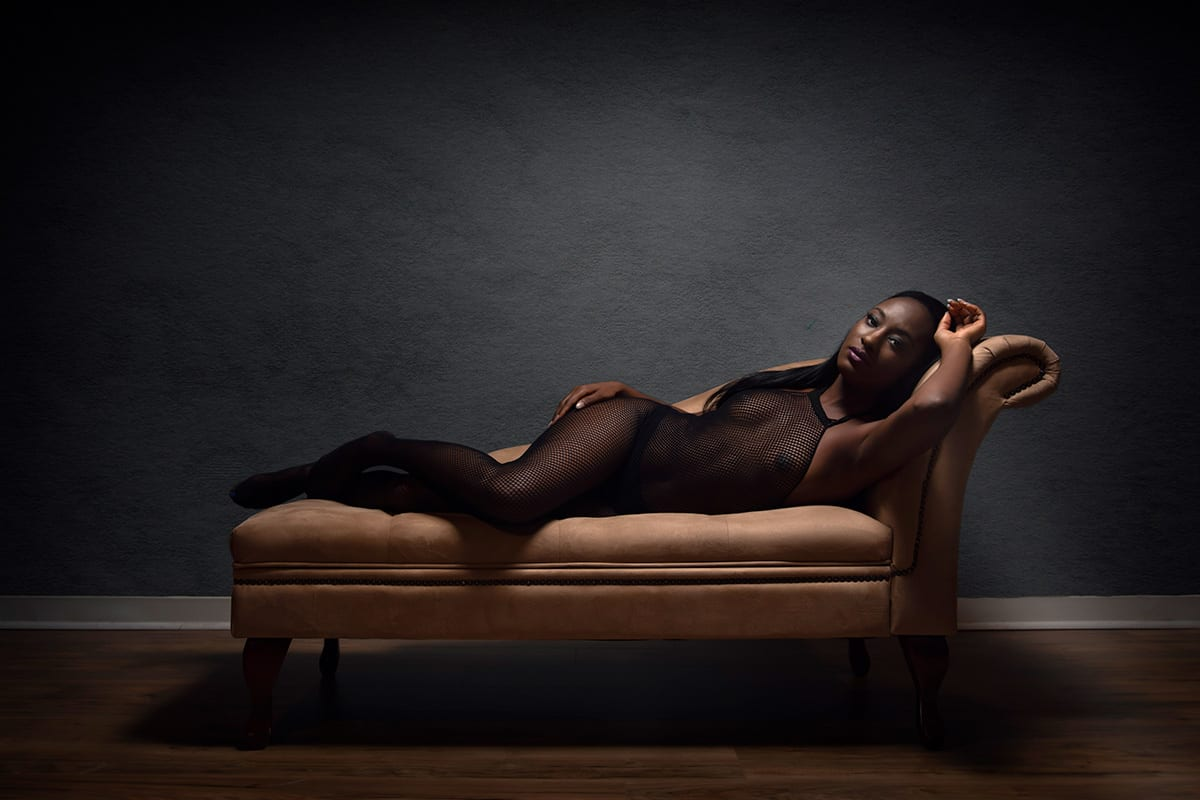 Boudoir pose on chaise lounge